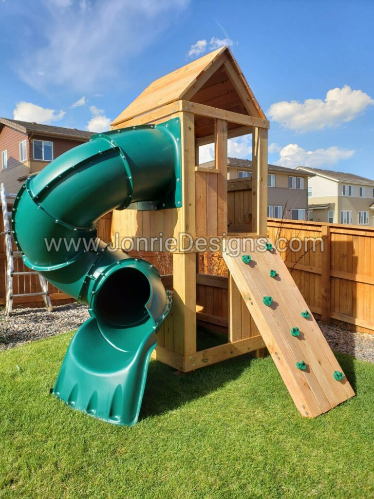 5'x5' Clubhouse with wooden roof, 4' Deck height, 5' Enclosed spiral slide, Rock wall entry, Enclosed bottom & Chalk board