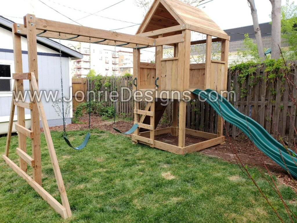 5'x5' Clubhouse with wooden roof, 4' Deck height, Standard slide, Rock wall entry, 8' Monkey bars with dual ladders & 2 Standard swings