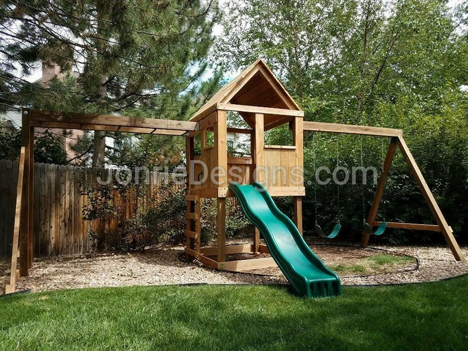 5'x5' Clubhouse with wooden roof, 4' deck height, Standard slide, 8' Monkey bars with dual ladders, 8' Swing beam with 2 Standard swings